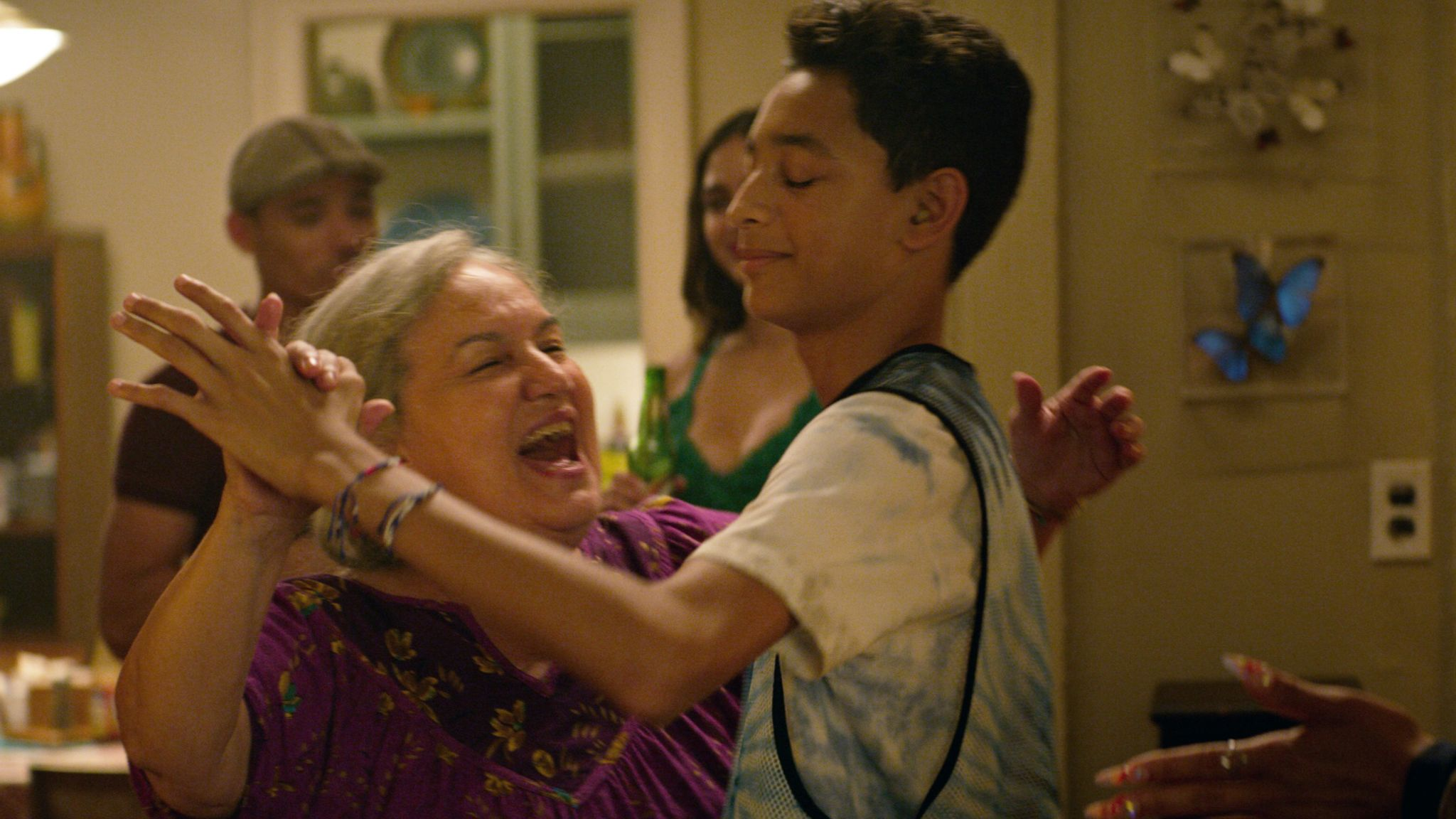 Abuela Claudia (Olga Merediz) and Sonny (Gregory Diaz III) share differing stories of immigration in the film. Pic: Warner Bros Studios