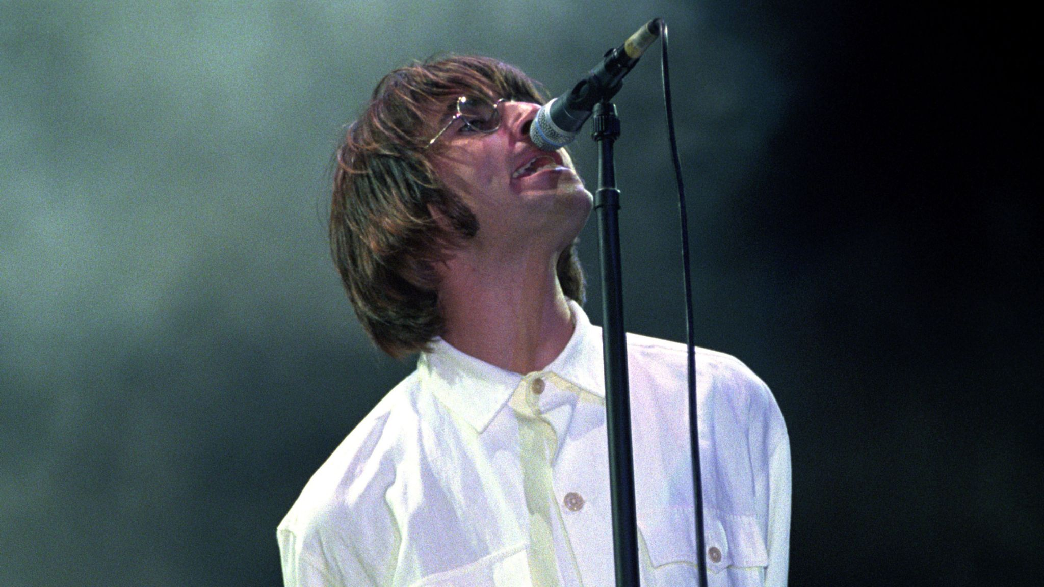 Oasis Knebworth documentary File photo dated 10/08/96 of Liam Gallagher performing with Oasis at Knebworth Park in Hertfordshire. Titled Oasis Knebworth 1996, the feature will debut in cinemas worldwide on Thursday September 23. Issue date: Tuesday July 13, 2021.