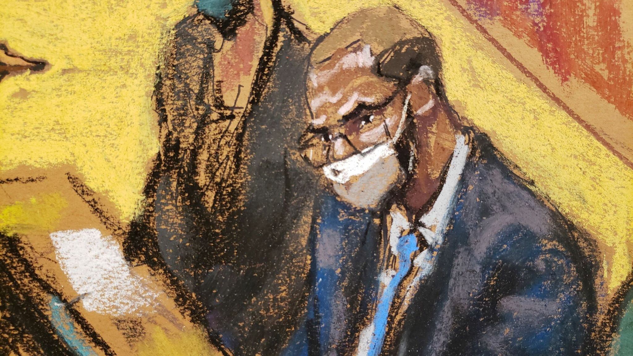 R Kelly listens in as the final closing arguments are made in his trial. Pic: Reuters